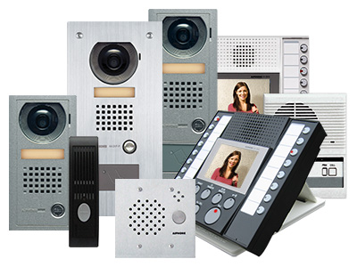 A grouping of AX Series exchange-based video intercom units. A black, desk mounted, video master, a stainless steel 2-gang audio only door station, a mullion mounted audio only door station, a surface mount, metal faced video door intercom, a flush mounted, stainless steel video door station with a built in card reader, a surface mount video door station with a built in card reader, a white video intercom master, and a surface mount audio only sub station.